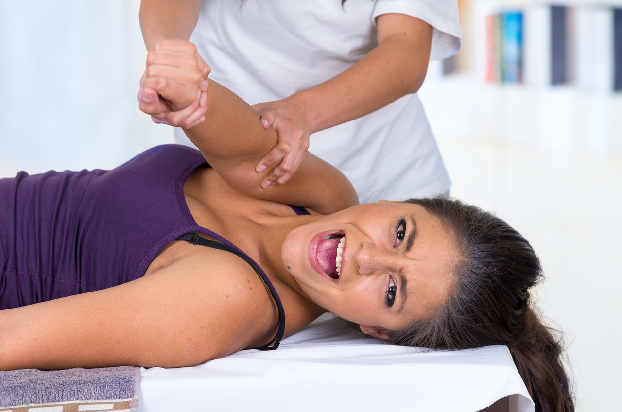 woman lying while getting a massage concept of physiotherapy